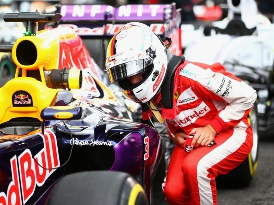 Vettel inspects the Red Bull's tyres
