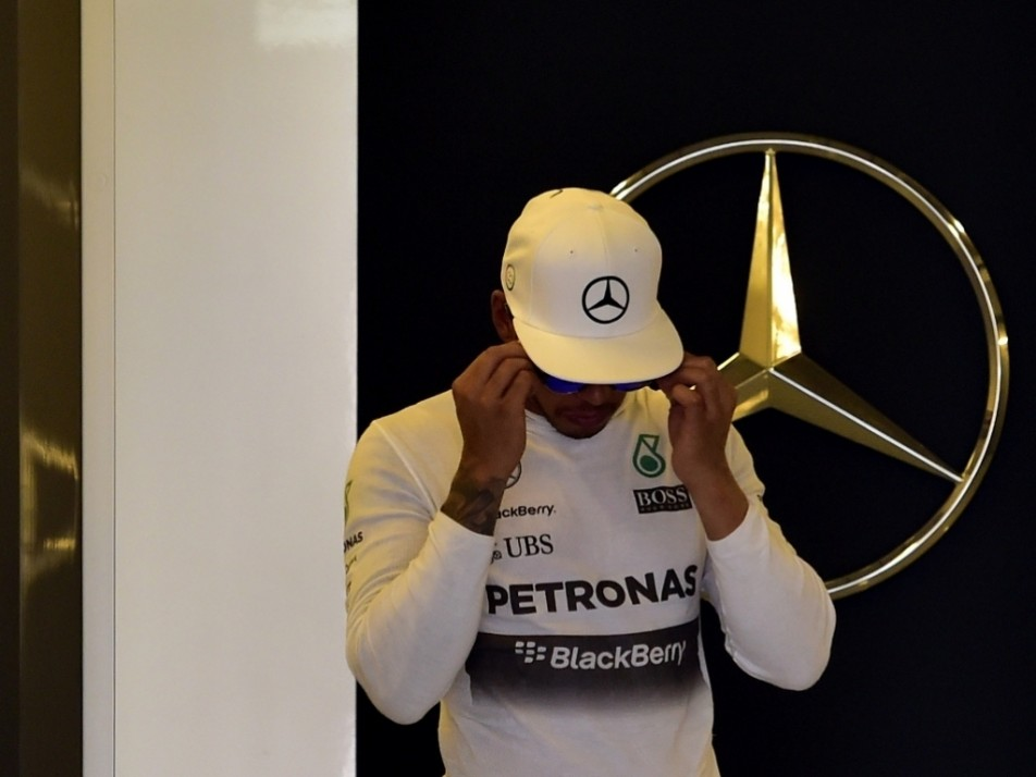 Hamilton takes a moment between sessions