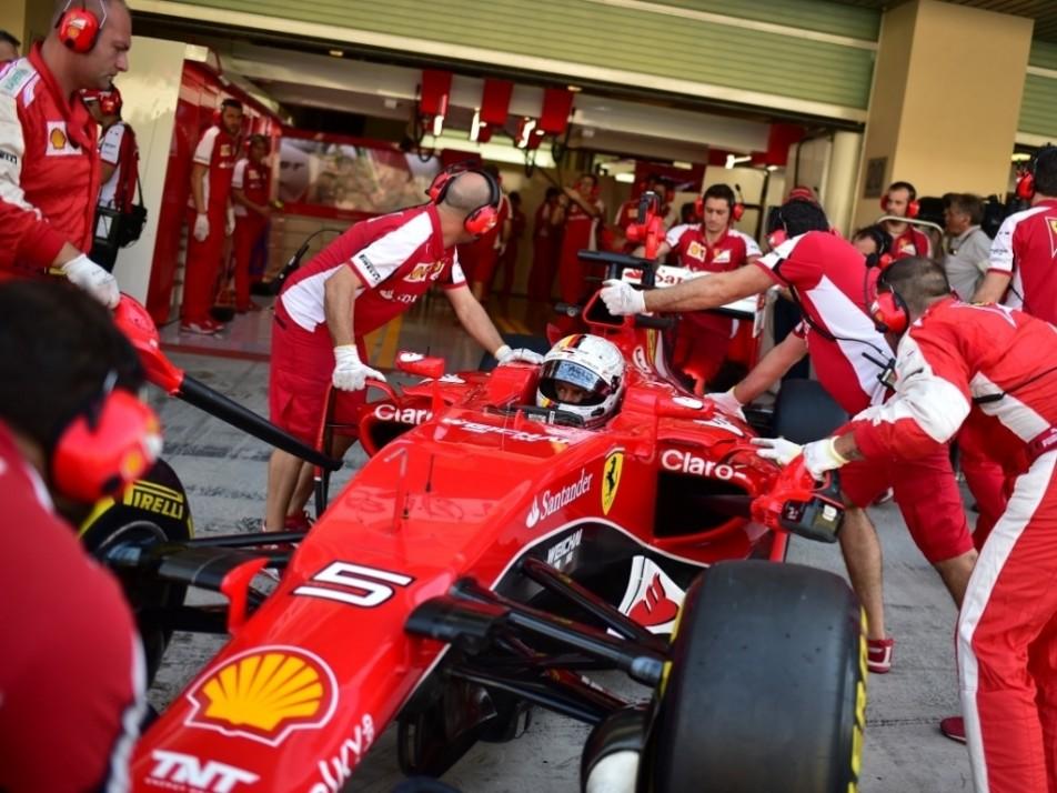 Vettel heads back into the Ferrari garage