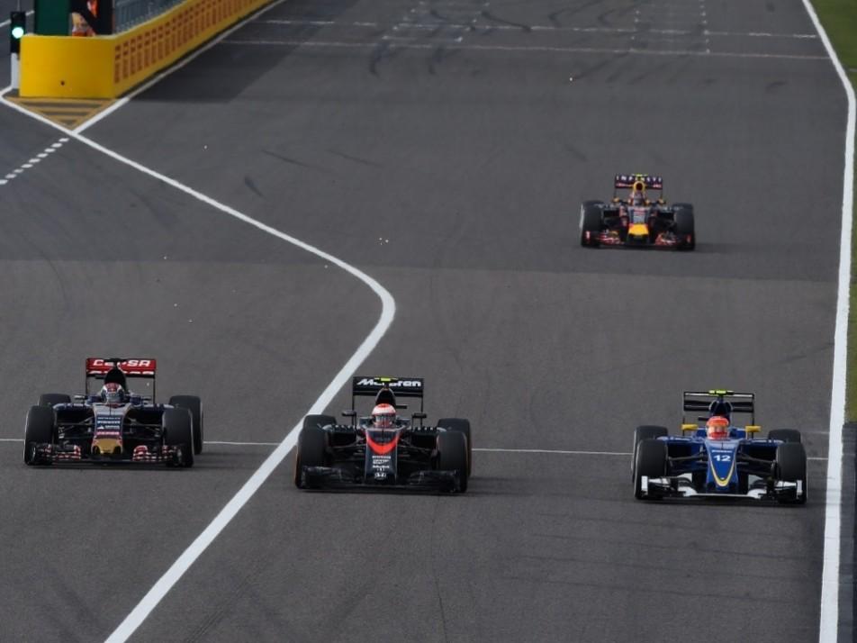 Max Verstappen and Felipe Nasr overtake Jenson Button into Turn 1 at Suzuka