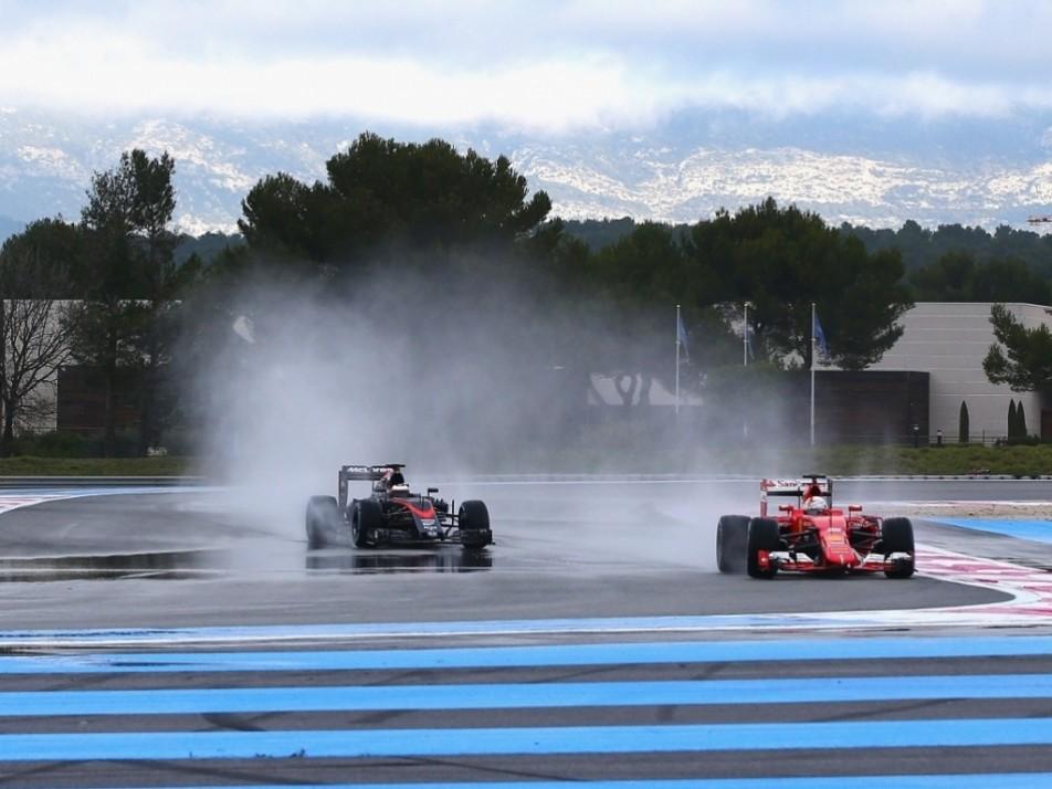 Vettel leads Vandoorne around the track