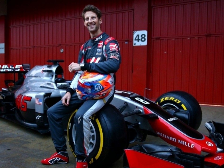 Grosjean smiling on his new car